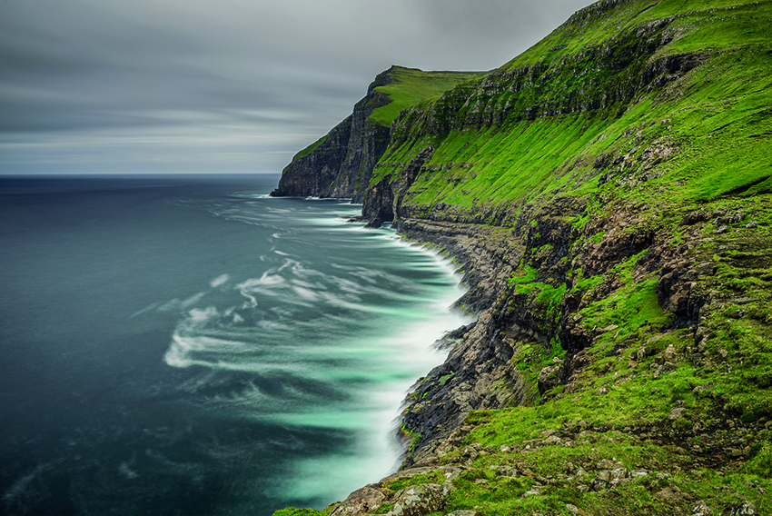 Giant sea cliffs shortly after storm on Faroe Islands. Long exposure.